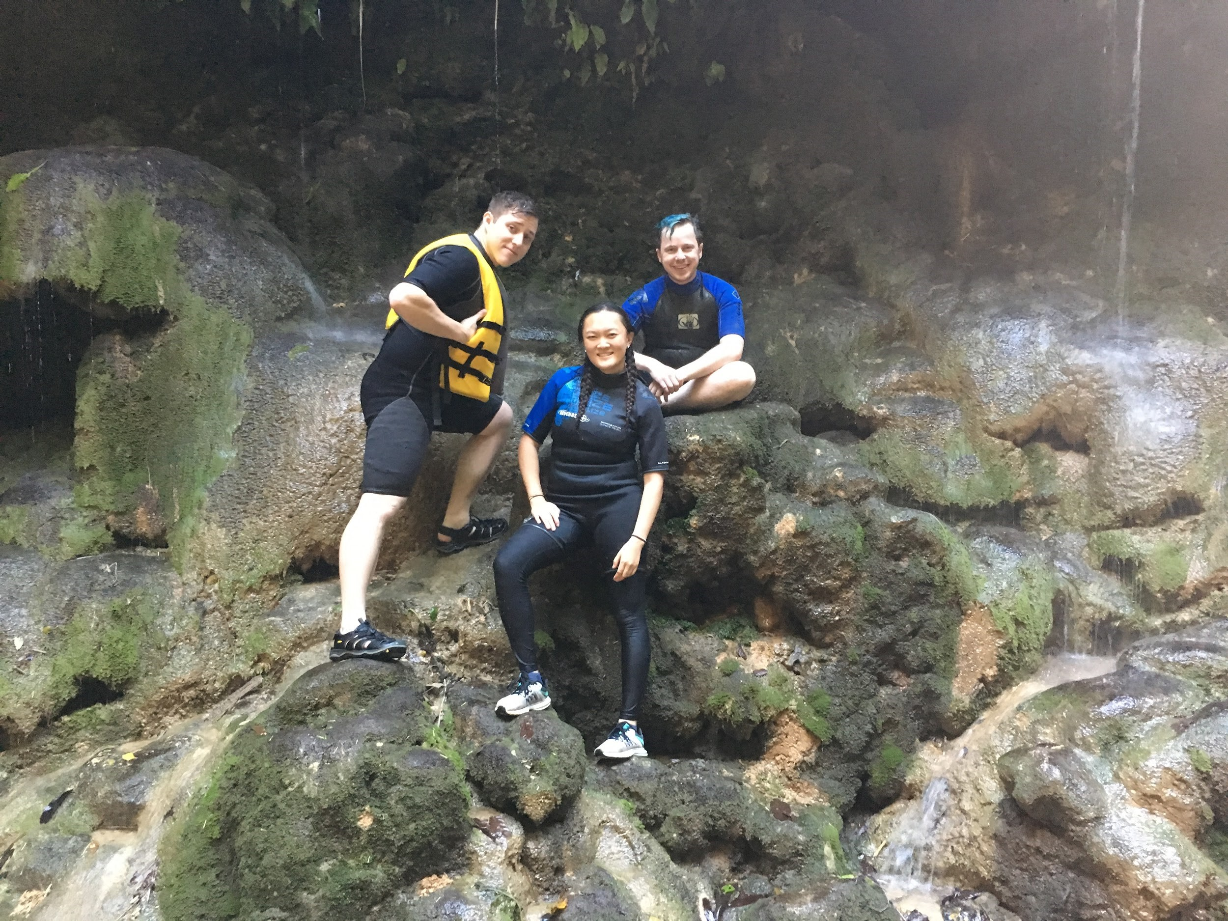 Group Picture outside natural spring waterfall
