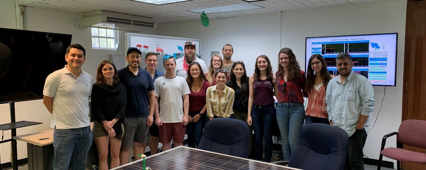 University of Minnesota students at the UPR Microgrid lab with Juan Felipe Patarroyo Montenegro, UPRM PhD student, and Professor Marcel Castro-Sitiriche.