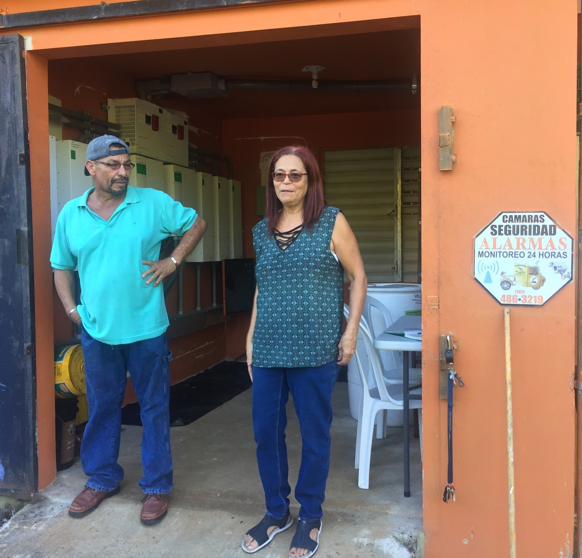 Cesar and Iris Irizarry explaining the mechanics of the pumping room