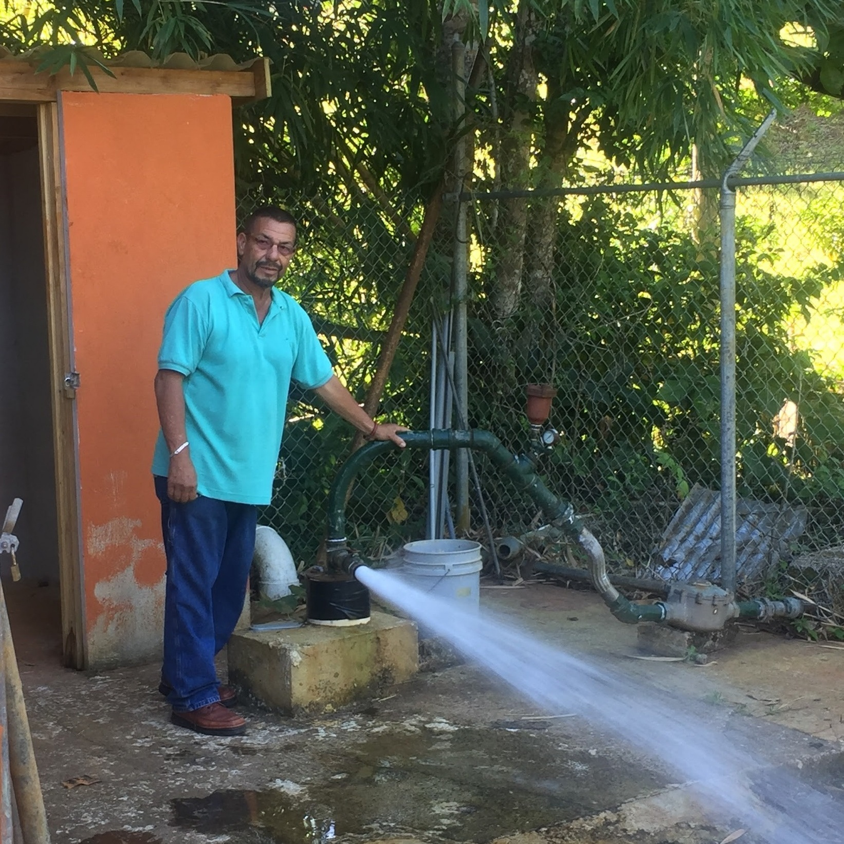 Cesar Irizarry demonstration the pressure behind one of two aqueducts