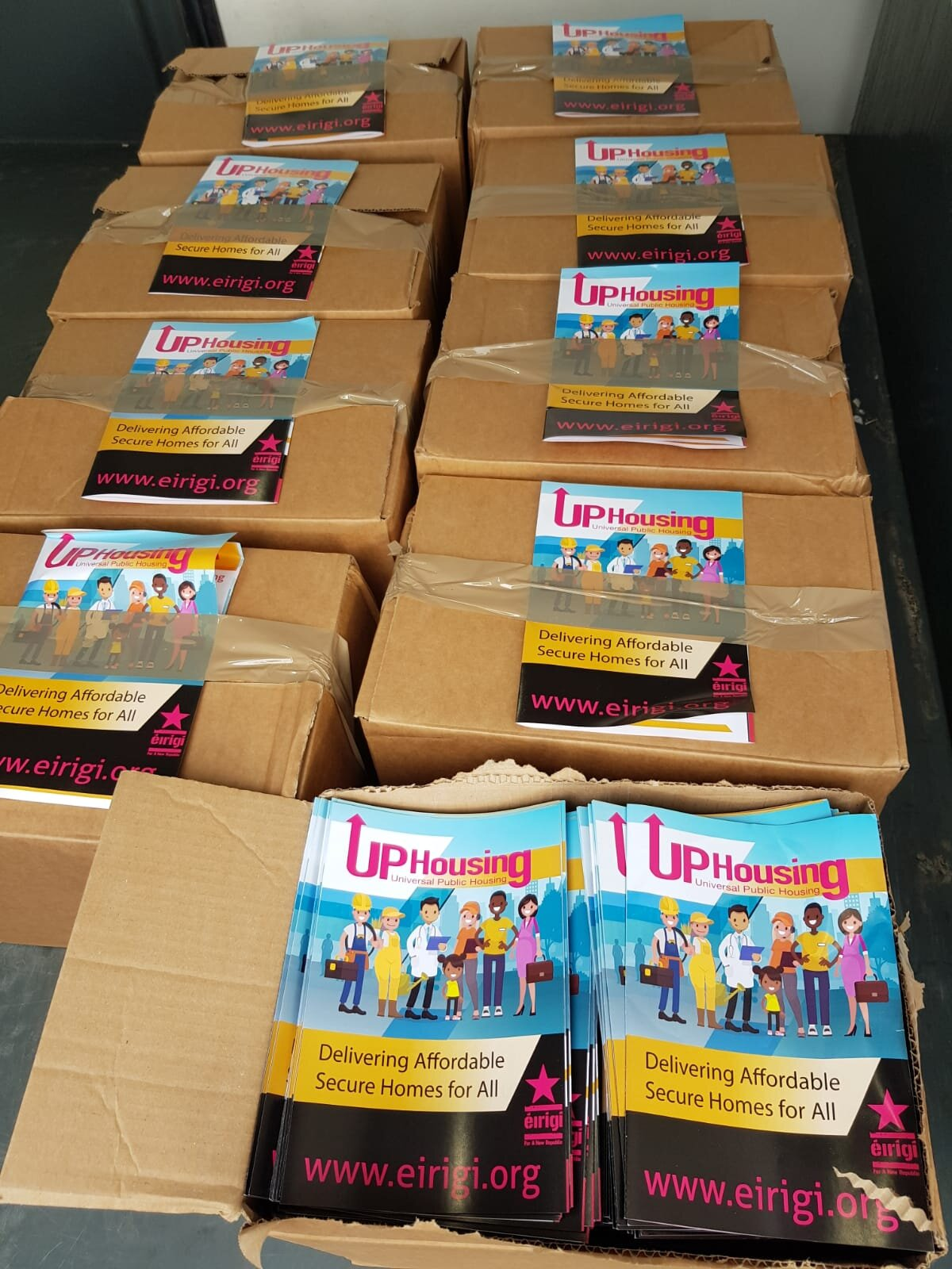 Boxes of the new six page UP Housing leaflet