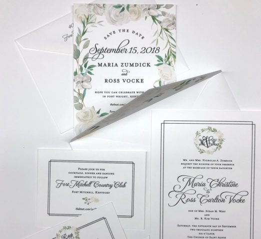Elegant green and white wedding invitation with floral designs