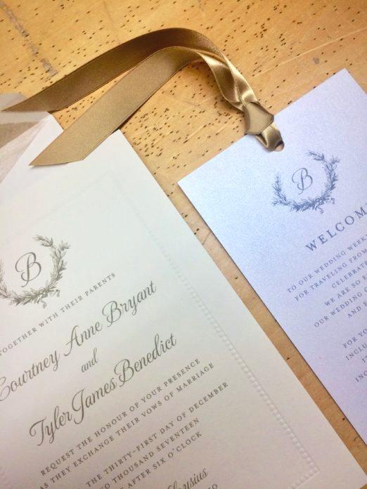Wedding invitation with beaded border on cream