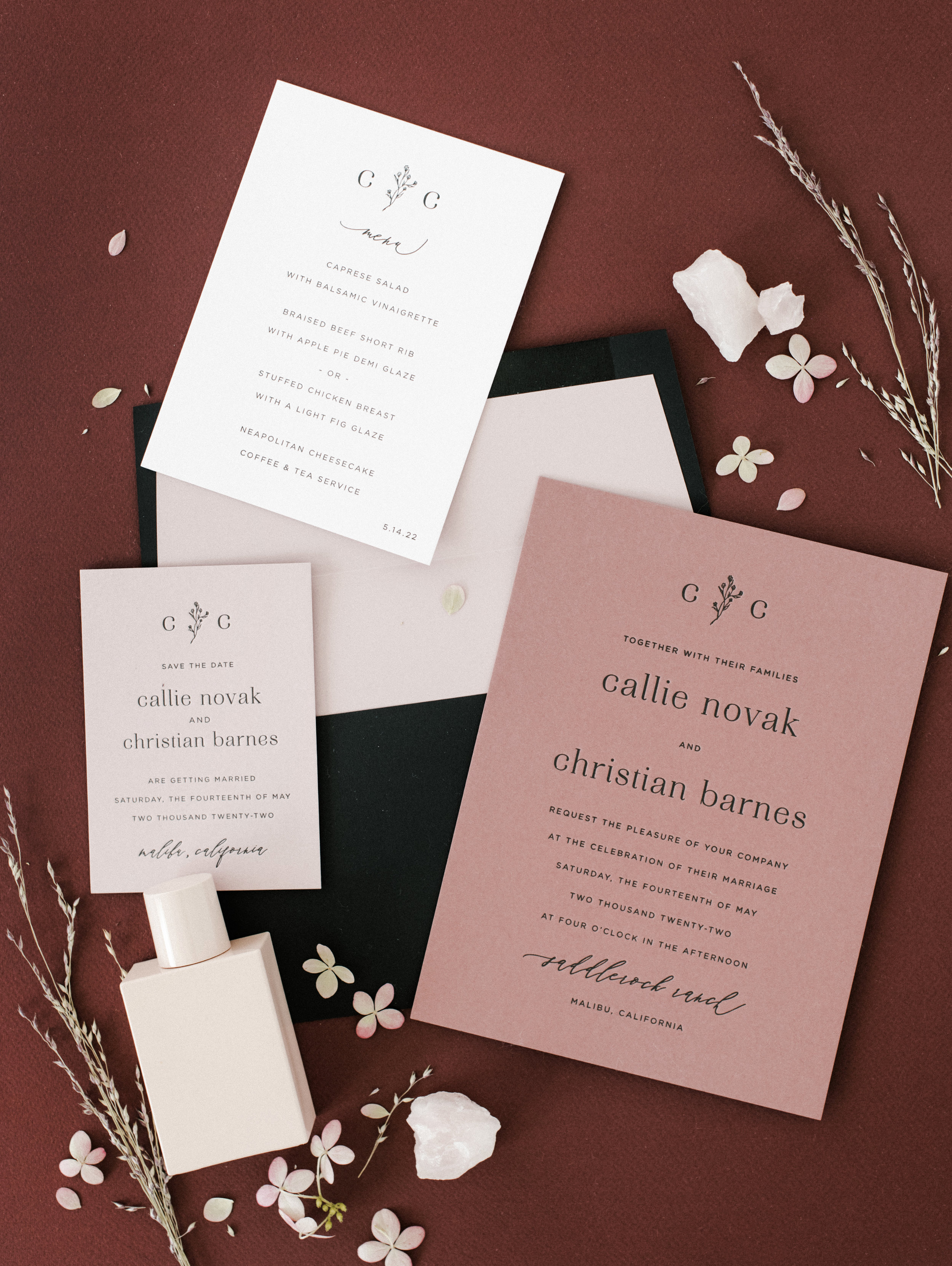 Rose, white and black letterpress wedding invitation.  photographer    Carina Skrobecki    and stylist    Cozbi Jean