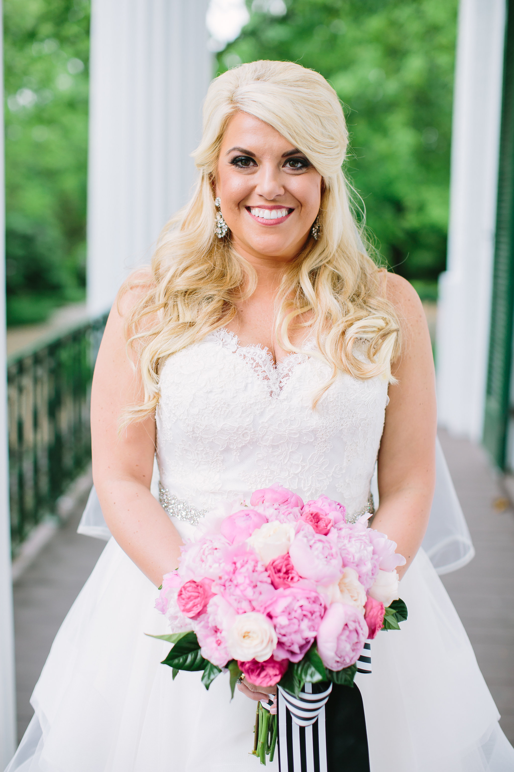 southern wedding with bright florals and black and white stripes.