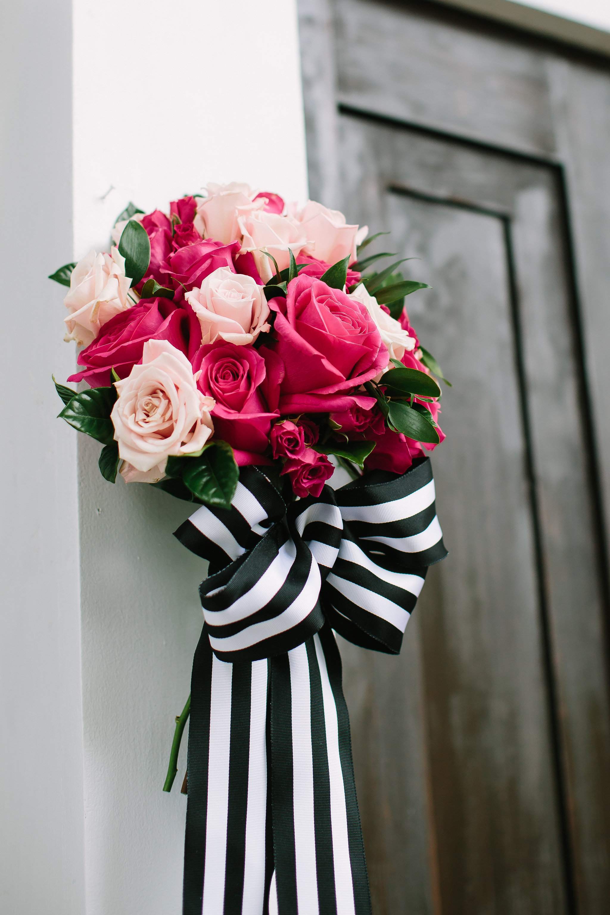 Classic black and white stripe with touches of pink floral were our theme.