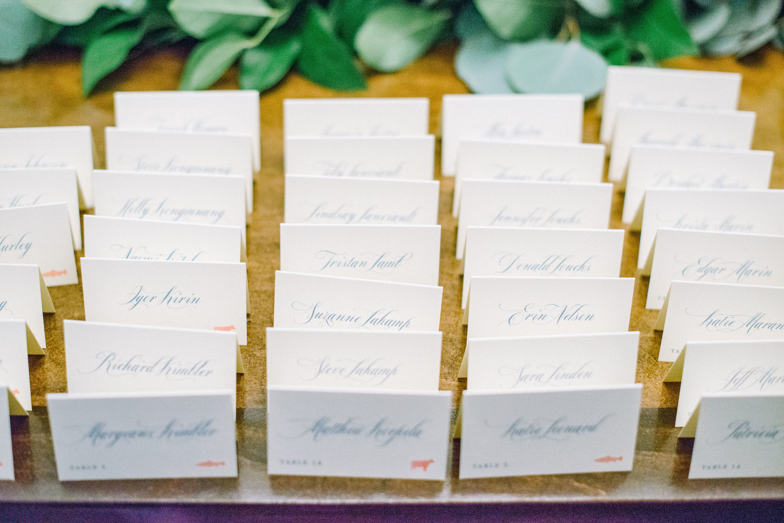 Escort cards with watercolor florals for Santa Monica destination wedding by Poeme.