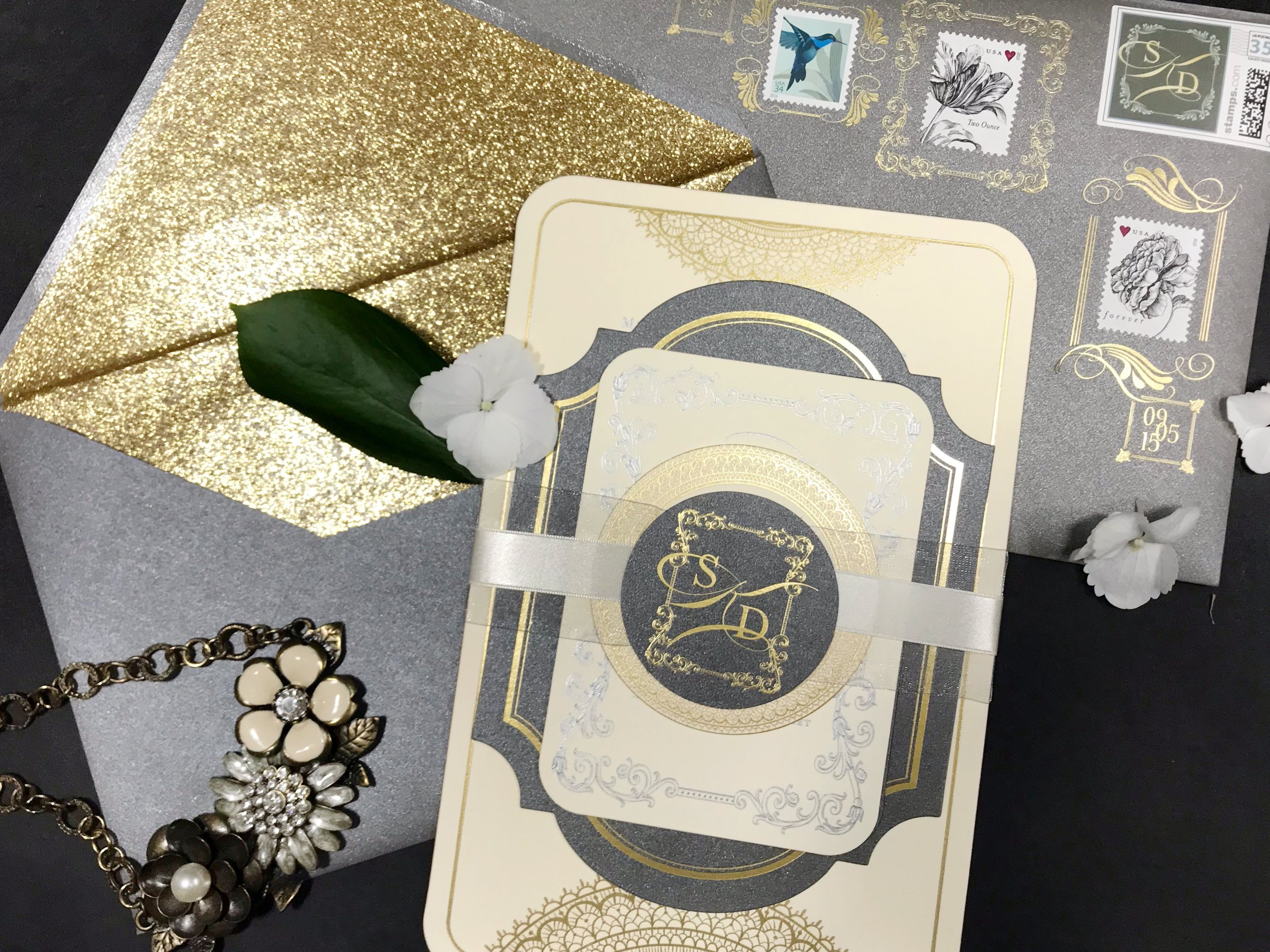 Gold and gray wedding invitation with custom elements by Poeme