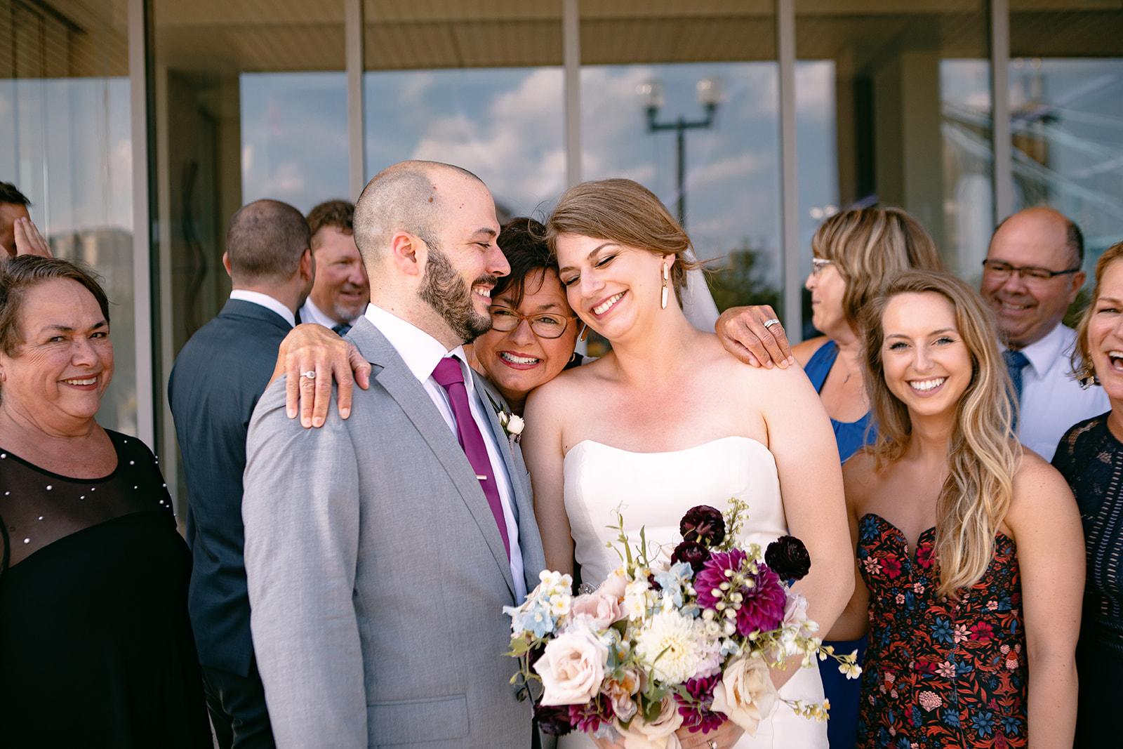 Cincinnati wedding celebration in summer at Roebling Bridge