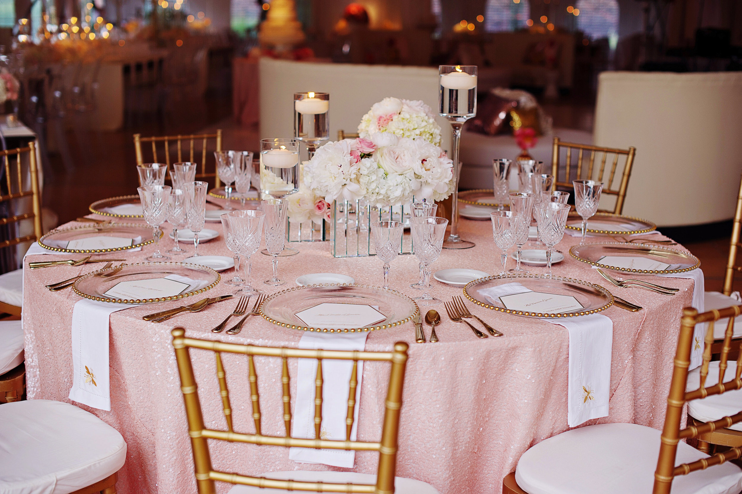 Table setting with pink linens for bee and honeycomb motif stationery for a Cincinnati Wedding at Pinecroft Estate.