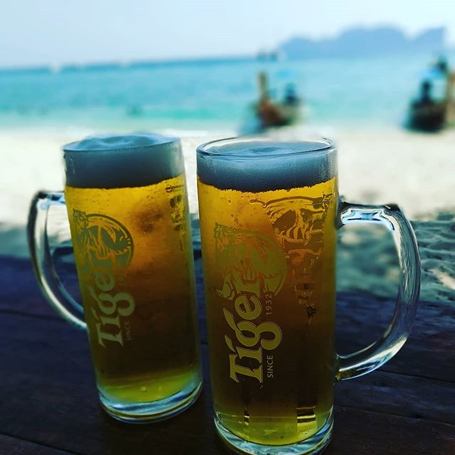 On our last day in Thailand, @paintedeye  and I were finally beat down by the Summer sun, so we found some draft beers and some shade and let the cool sea breeze send us away. Love you, babe, and so happy to be home 🐼  Bonus points: the island seen in the background is Maya Island, the island from the movie The Beach 🥰