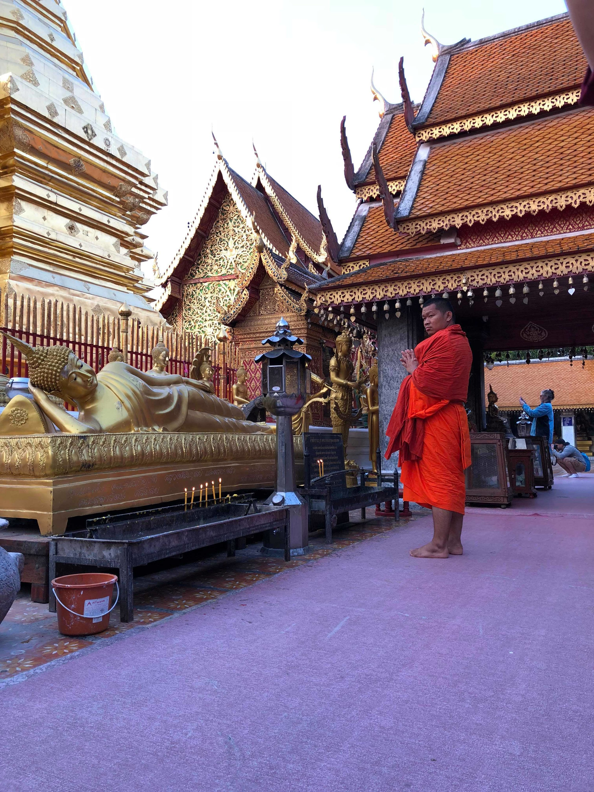 A monk worshiping in the inner sanctum of Doi Suthep.  Photo by Heather Marie