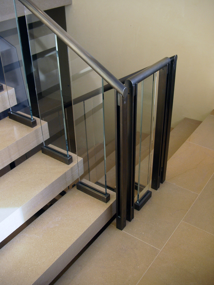Bronze Railing with Patina and Glass Panels