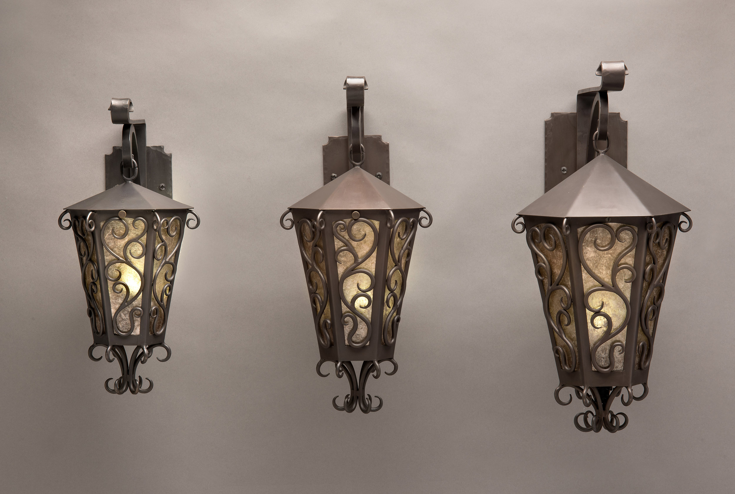 Bronze Sconces with Mica Shade. Wrought Iron Style