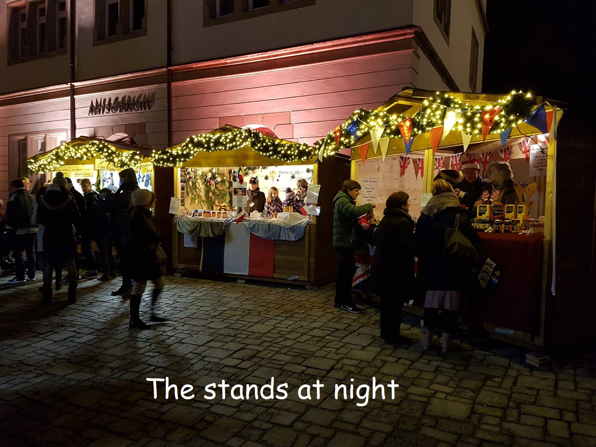 Annonay & Chelmsford stands at night titled.jpg
