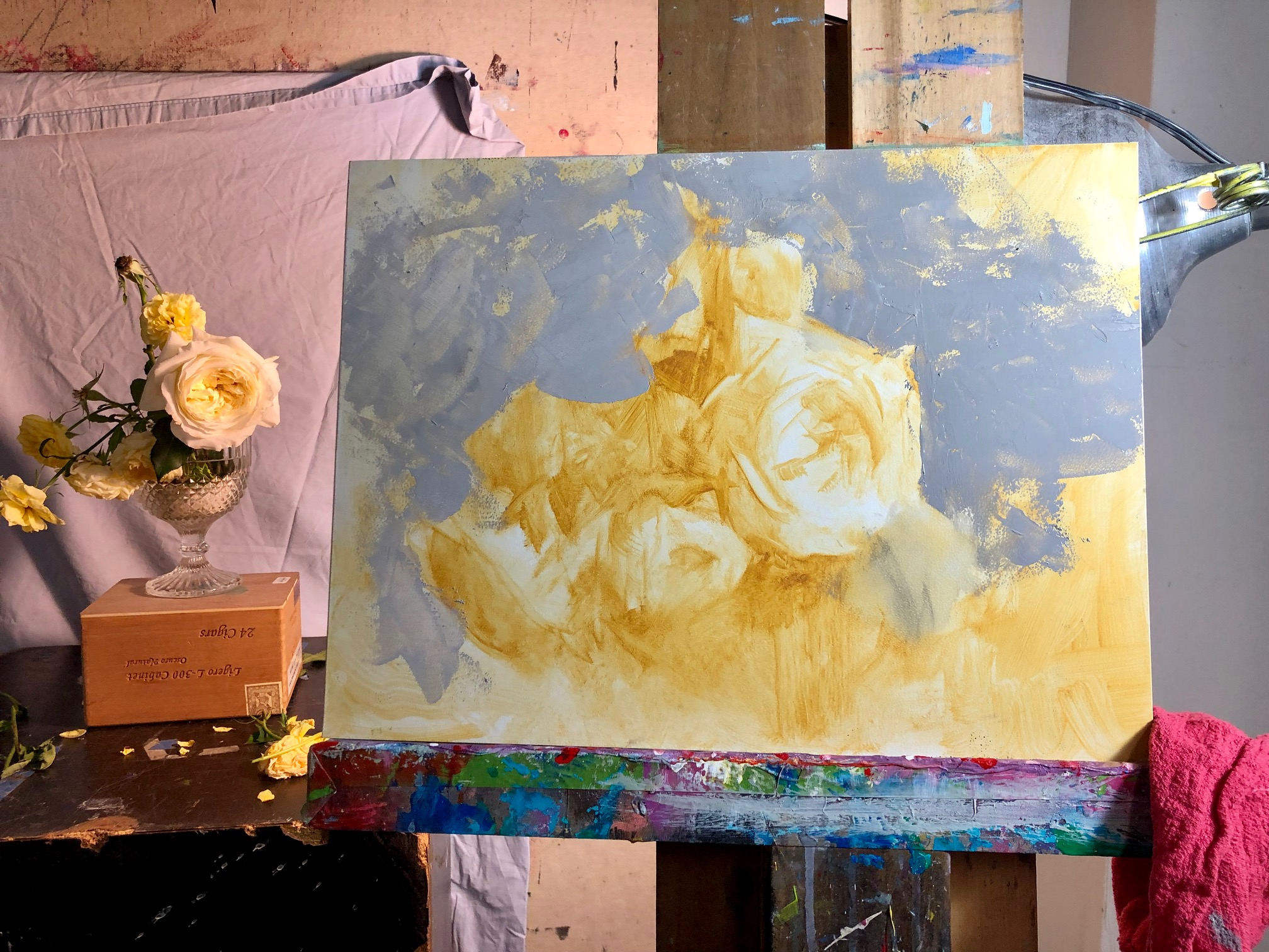Underpainting with background lay in.