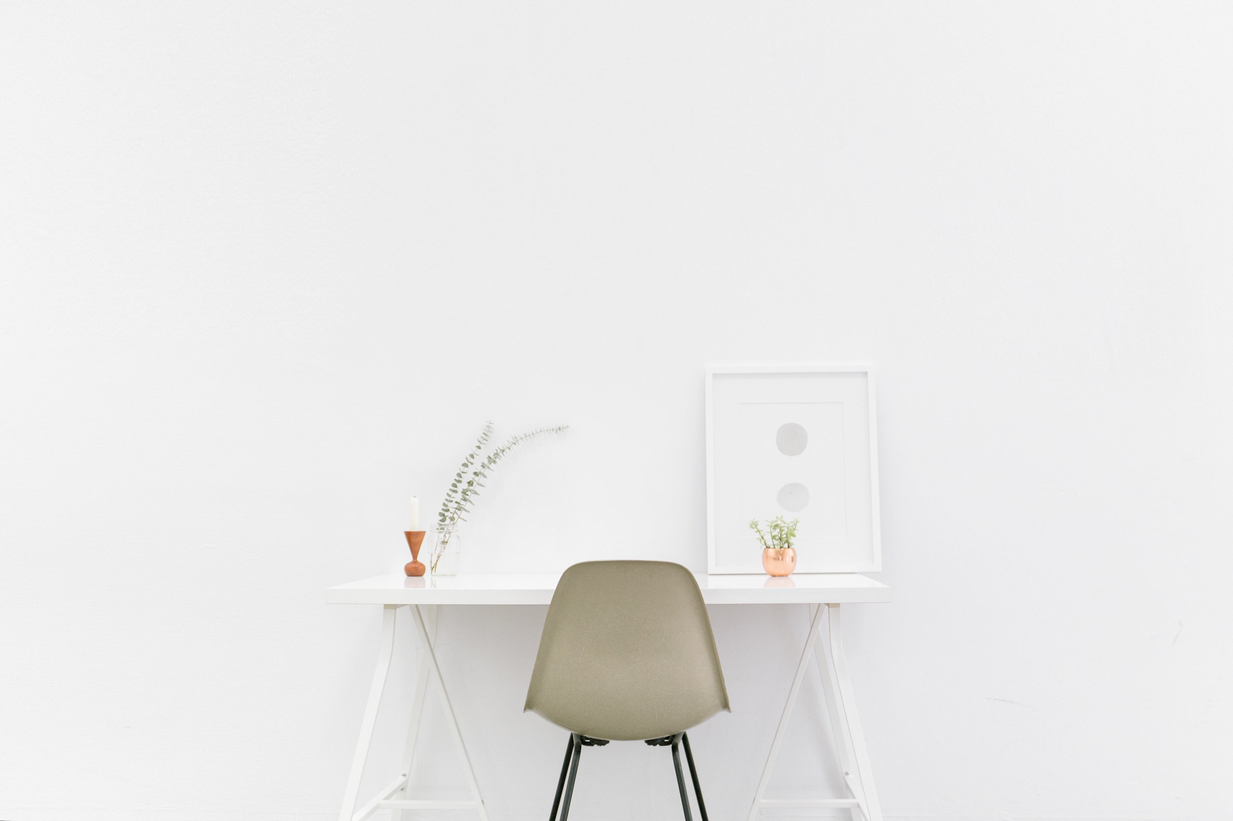 Canva - Beige and Black Chair in Front of White Desk.jpg