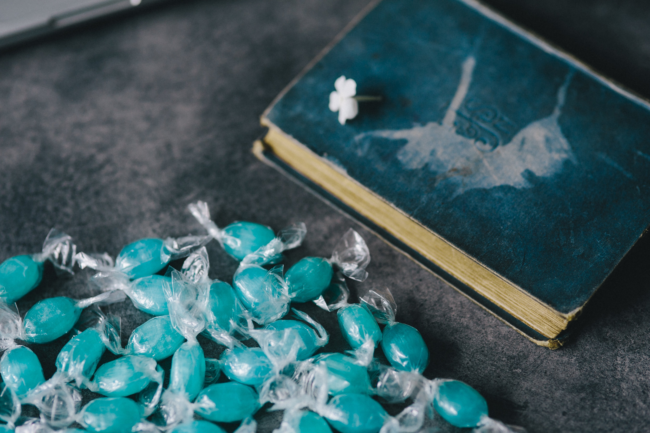 kaboompics_Book and blue candy.jpg