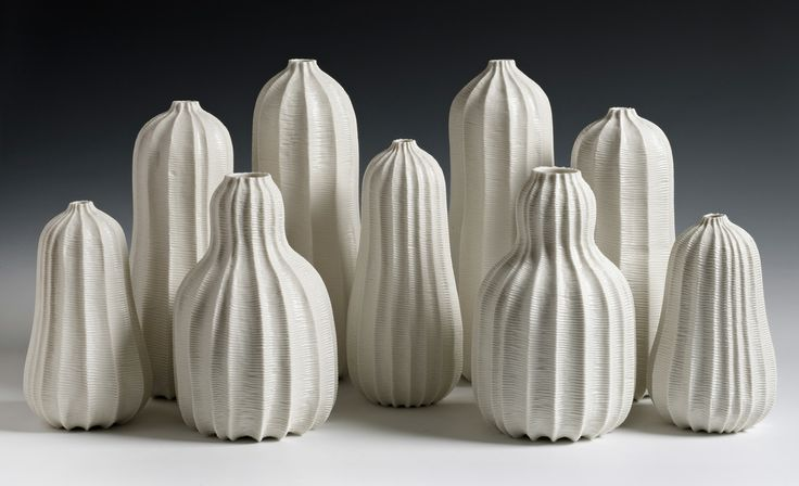 Andrew Wicks, Garniture of Seven Vases, 2013. Thrown and carved porcelain.