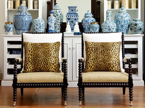 Bobbin chairs remain very popular and these look terrific with the leopard pillows and accessorized with all those blue and white ceramics.