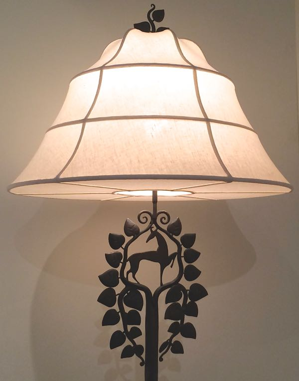 4. Who designed this beautiful figural floor lamp?