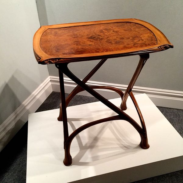 5. What is the name of the designer of this metal work and table? Bonus points if you know the name of the period.