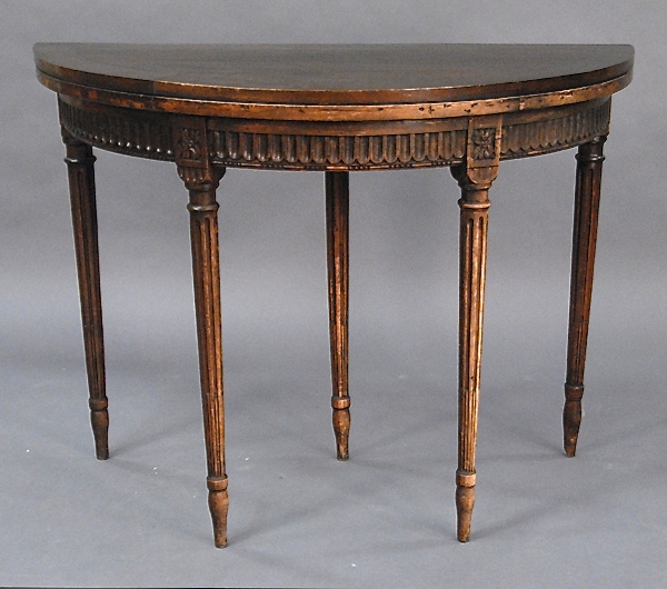 Demilune table with fluted skirt and fluted legs, early 19th century.