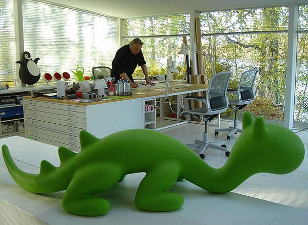 Eero Aarnio in his office. Can't miss the darling dragon, but look for the penguin and mini ball chairs