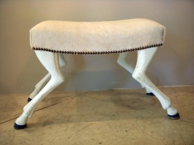 """The """"Tabouret Chevre"""" bench below is part of the A La Reine Collection by Myra Hoefer Design. It is inspired by John Dickinson's hooved tables and chairs."""