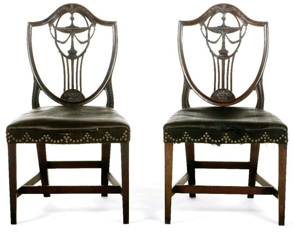 Federal mahogany shield back side chairs attributed to Samuel McIntire with kylix and Prince of Wales feather splats over upholstered serpentine front seat on tapered legs