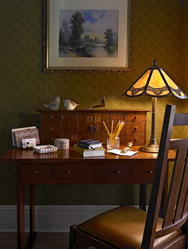 Marquetry decorates this Arts and Crafts style desk. Photograph by Ellen McDermott