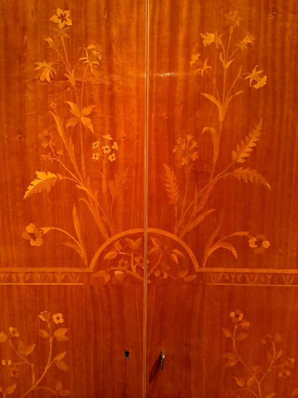 Close up of the marquetry on the Carl Malmsten cabinet.