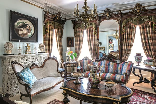 Hunt Slonem's Cordts Mansion. Fabric on the two sofas by Lee Jofa.