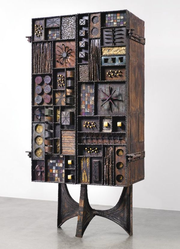Sculpted-front cabinet by Paul Evans. Photo via Sotheby's