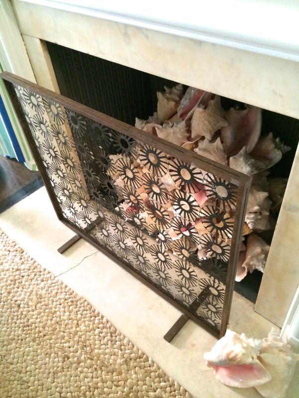 Conch shell filled fireplace by Gary McBournie at Holiday House NYC