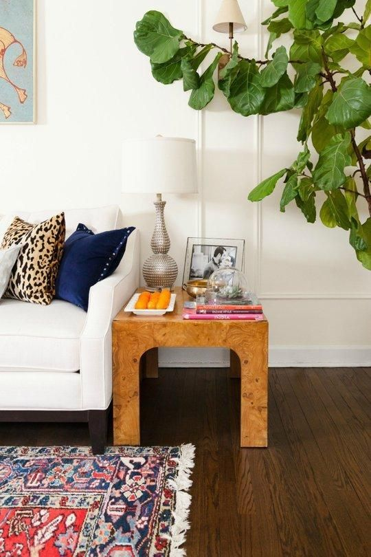 Love the burl wood side table.