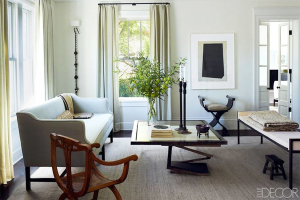 A chic room with two different forms of the curule seat.