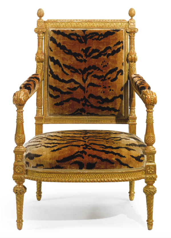 Lot 19: A Louis XVI style carved giltwood fauteuil 19th century Estimate 4,000 — 6,000 USD Photo by Sotheby's