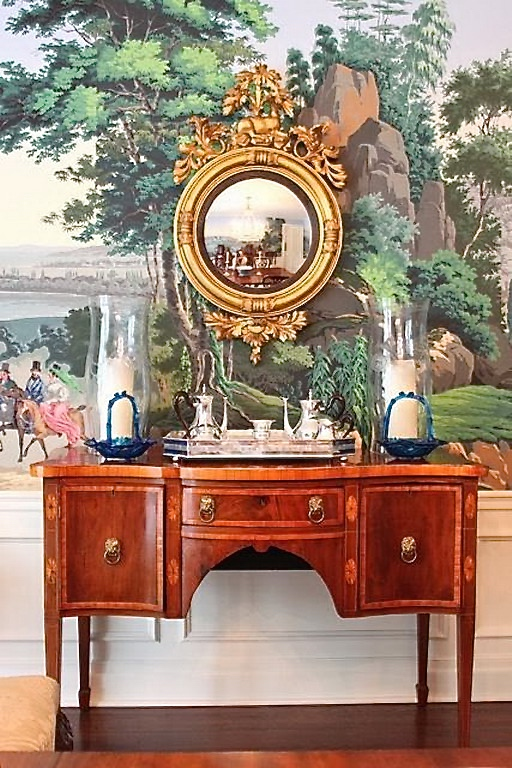 A Sheraton sideboard against Zuber wallpaper. Note the veneers and inlays, plus the lions head hardware.