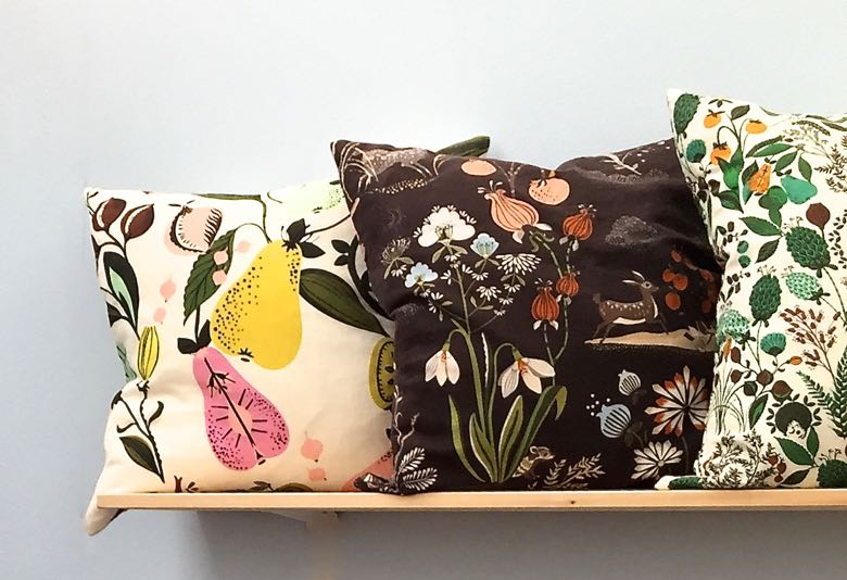 PIllows in a brand new line of fabrics by British ceramist and illustrator Louise Wilkinson.