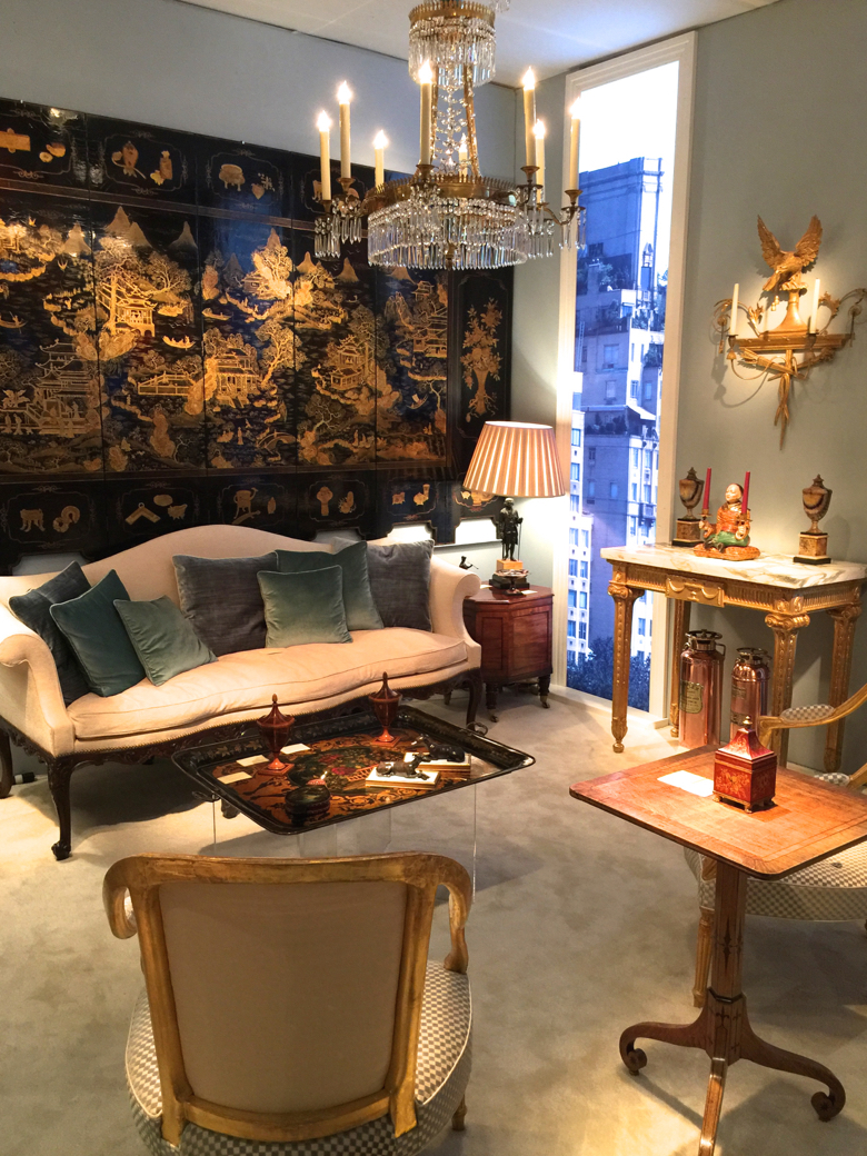 Dealer Apter-Fredericks created a room with a view at the Winter Antiques Show by backlighting images of New York for windows.
