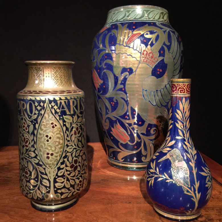 These hand-painted vessels are richly hued with Persian patterns.