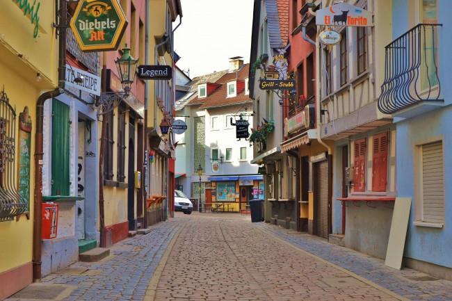 A colorful, cobblestone street in Frankfurt, Germany