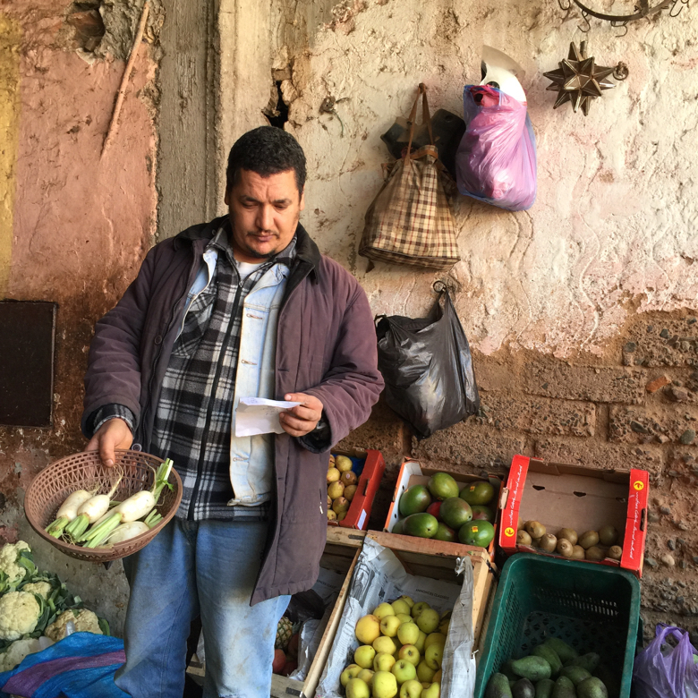 Man selling vegetables in the Medina. Marrakech, Morocco.