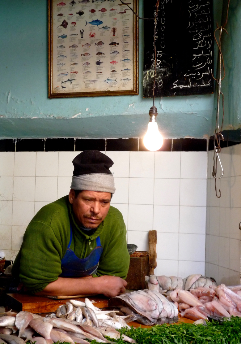A fish monger in the Medina in Marrakech Morocco