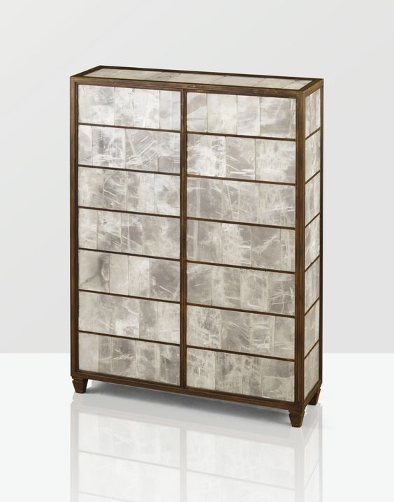 A Gypsum and patinated bronze cabinet by Jean-Michel Frank. c. 1935