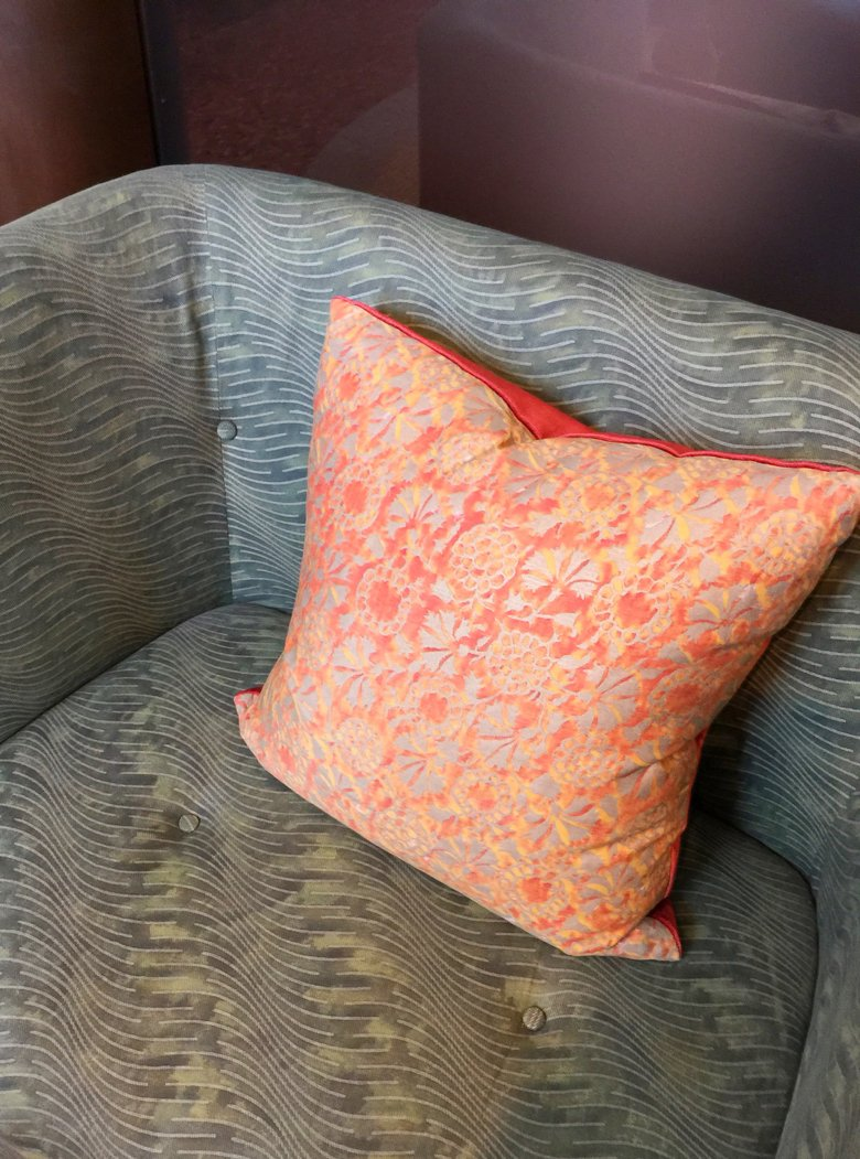 Chair and pillow in Fortuny fabric from the Fortuny Showroom in Venice