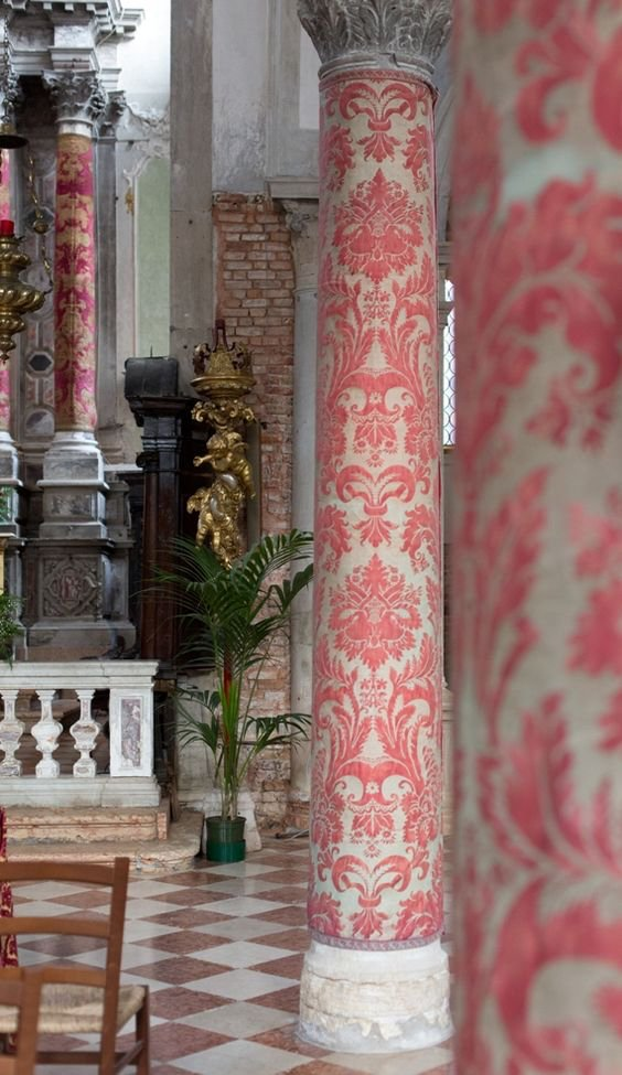 Columns in the Venetian church Sant' Eufemia on the island of Guidecca are covered in Fortuny fabric from Christmas to Easter