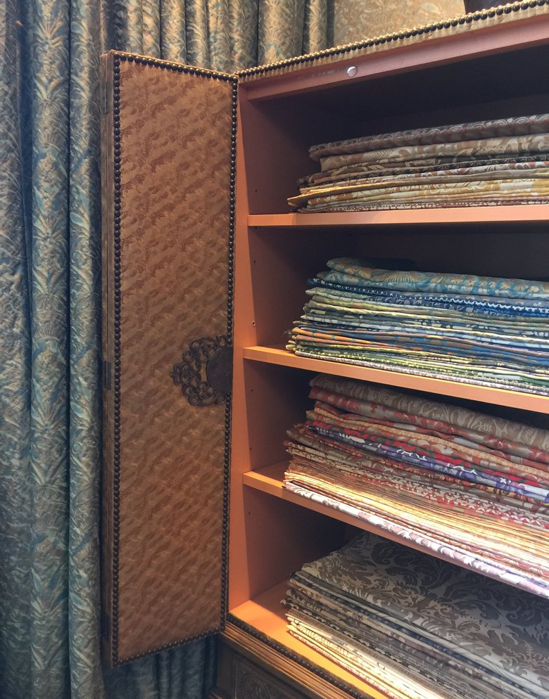 A cupboard full of Fortuny fabrics from the Fortuny showroom in Venice