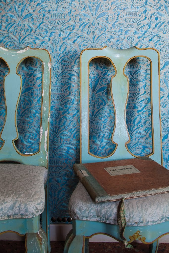 Beautiful turquoise room upholstered with blue damask Fortuny fabrics and furnished with Queen Anne style chairs